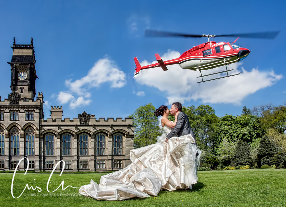 Carlton Towers wedding photography, bride and groom with a helicopter at Carlton towers wedding venue.