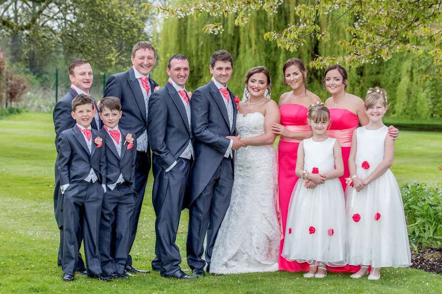 The bridal party on the lawns of The Old lodge wedding venue in Malton