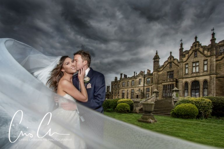 Allerton Castle Wedding Photography, bride and groom outside the castle in North Yorkshire.