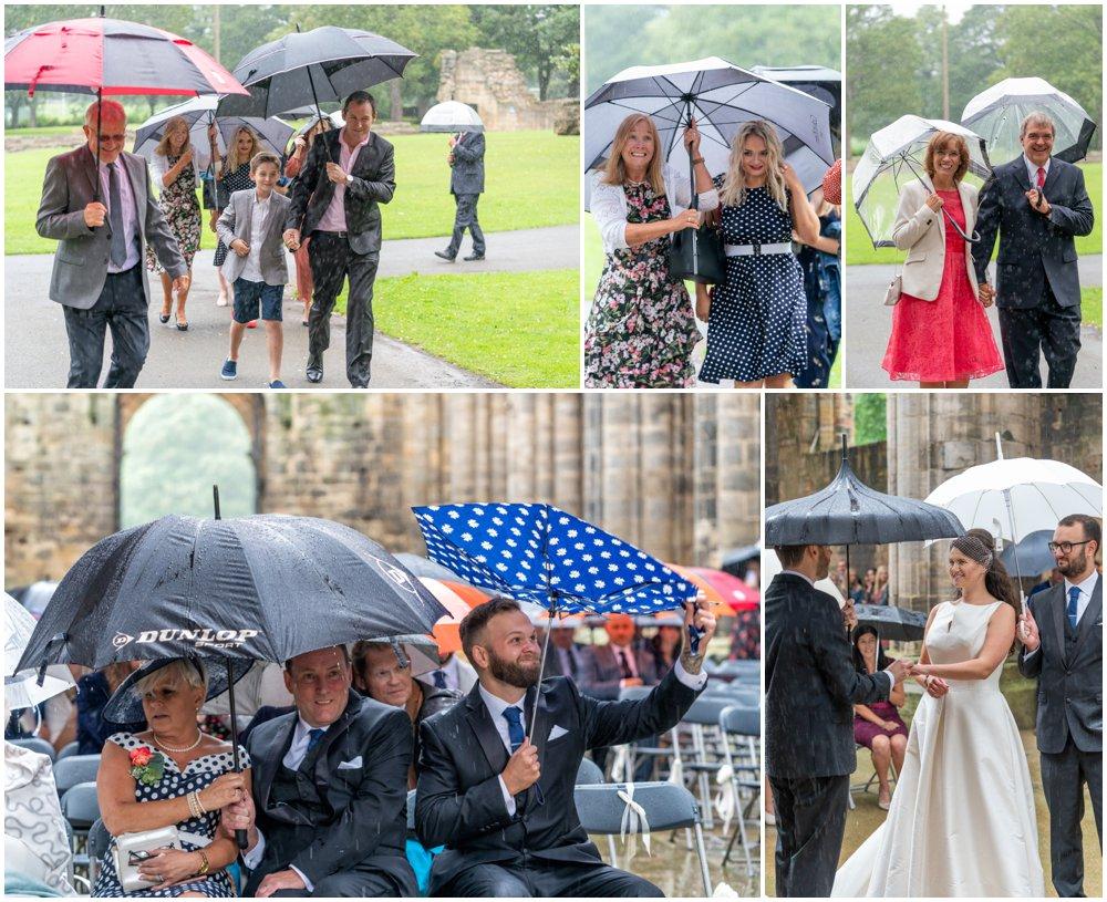 preparing for wet weddings - umbrellas at a wedding