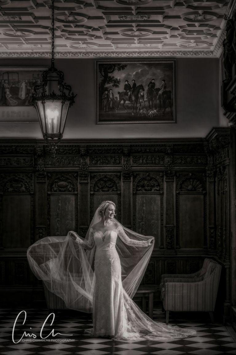 Hazlewood Castle wedding photograph, chris chambers wedding photographer. Bride in the flemish hall at hazlewood castle