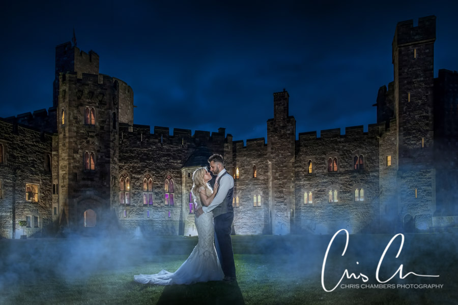 Bride and groom at Peckforton Castle. Award winning wedding photographs at Peckforton Castle