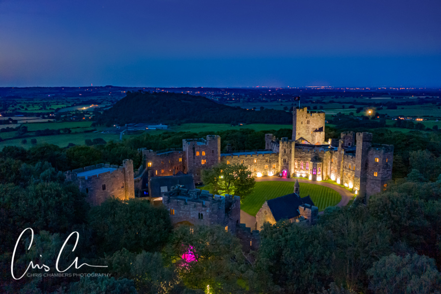 Peckforton Castle wedding venue after dark. Cheshire castle