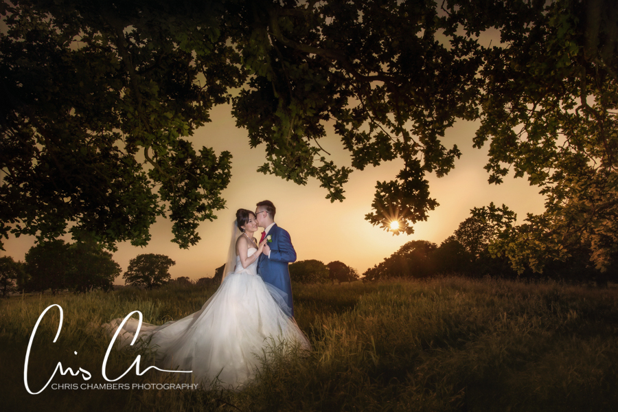 Allerton Castle wedding photograph showing the bride and groom at sunset
