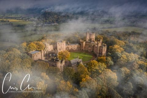 Peckforton Castle Cheshire, exclusive castle wedding venue photographed through the mist