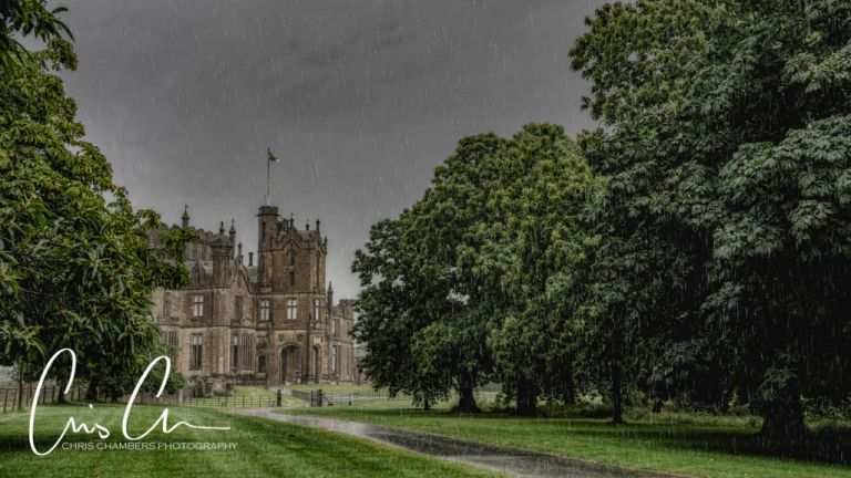 Allerton Castle fairytale North Yorkshire wedding venue, photographed from the driveway in heavy rain. Beauty and the Beast Themed wedding.