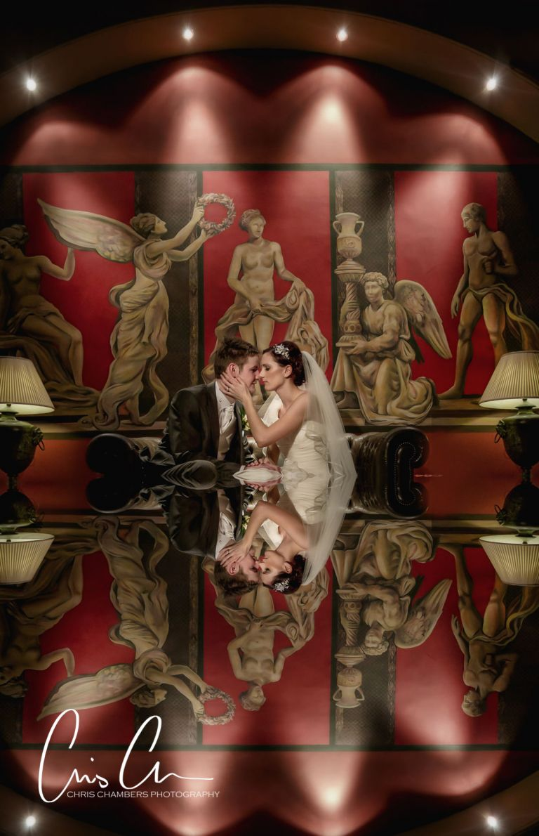 Bride and groom reflected in the bar Swinton Park - Wedding Photograph