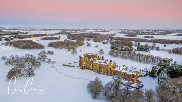 Allerton Castle in the snow, drone photo aerial view of the historic north yorkshire castle
